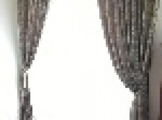細部までこだわり抜かれたお部屋の落ち着きと上品さとマッチするカーテン